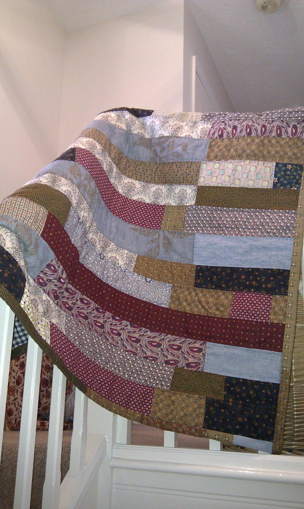 modern patchwork handmade quilt in stripes of blue burgundy and brown boys quilt lap quilt