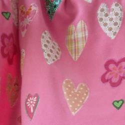 pink baby blanket with hearts and flowers